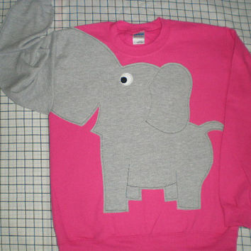 Bright pink elephant trunk sweatshirt. Adult size large.