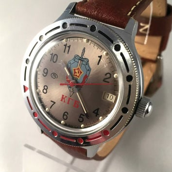 "RARE VINTAGE men's Automatic Vostok ""Komandirskie KGB"" agent watch.This watch comes with brand multi-functional leather band. see pics!"