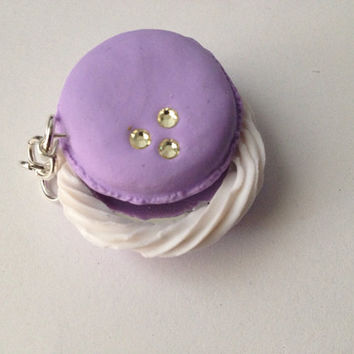 Lavender macaroon charm with a mirror inside.