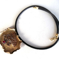 Necklace , Jewelry , Pendant , Metalwork , Brass Metal Alloy, The Pendant With Black Leather.