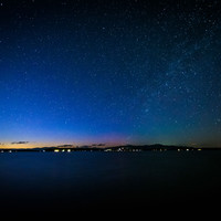The Milky Way over Lake Winnipesaukee at night, at Ellacoya State Park, in Laconia, New Hampshire.