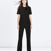 Fitted jumpsuit with flap pockets