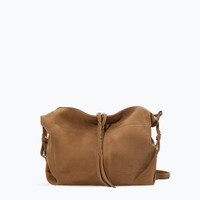 Leather and suede messenger bag