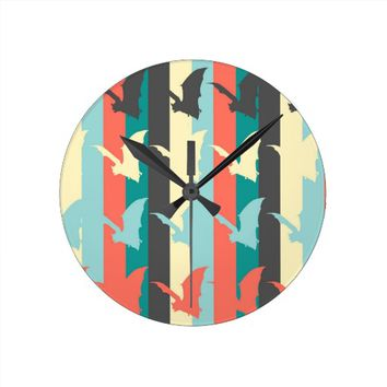 bat silhouette with striped bacground round clock