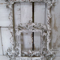 White ornate wall frames accented in gray pewter and deep gold French farmhouse wall decor Anita Spero