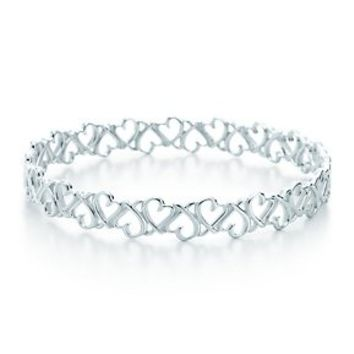 Tiffany & Co. -  Paloma Picasso® Loving Heart bangle in sterling silver, medium.