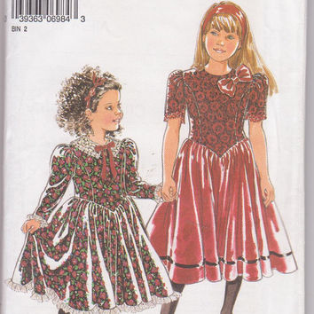 Childs party dress pattern with shaped waist, princess seams and long or short sleeves girls size 4 5 6 7 8 9 10 New Look 6984 UNCUT