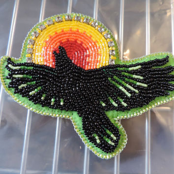 Soaring Raven and the Sun Brooch