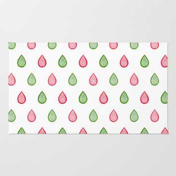 Pink and green raindrops Rug by Savousepate