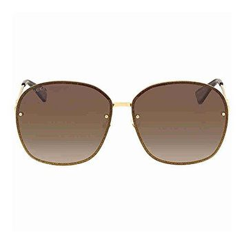 Gucci GG 0228S 003 Gold Metal Oval Sunglasses Brown Gradient Lens