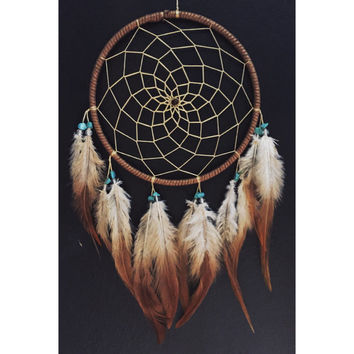 Bronze and gold flecked faux suede trim dream catcher, gold yellow web, real turquoise beads, rooster feathers finish 15cm diameter dreamcat
