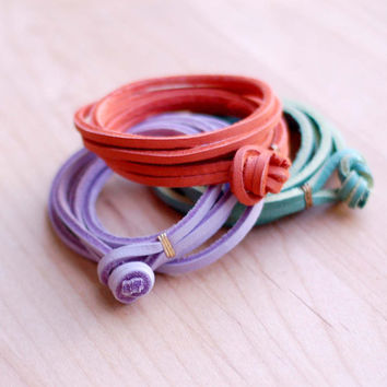 Orange, green or purple leather wrap bracelet, knot closure, gold or silver detail.
