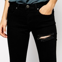 ASOS PETITE Whitby Low Rise Skinny Jeans in Clean Black With Thigh Rip