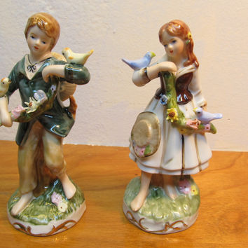 PORCELAIN FIGURINE OF A BOY AND GIRL