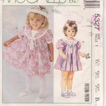 Laura Ashley pattern for toddler pleated tent dress with short puffed sleeves and wide collar with dickey child size 1 McCalls 5327 UNCUT