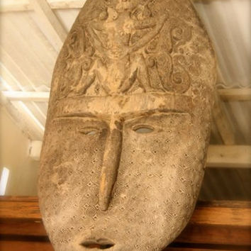 Timor carving,wood statue ,sculpture,antique,tribal,rustic,artefact,mask.
