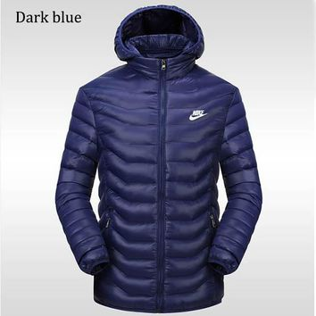 NIKE 2018 winter new sports and leisure detachable hat warm down cotton padded clothes Dark blue