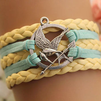 HUNGER GAMES inspired mockingjay bracelet with retro silver arrow,green rope,yellow braid leather---B298