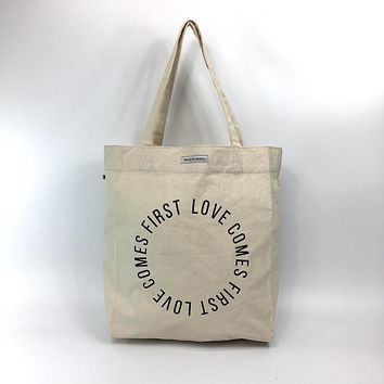 MARKET TOTE WORLD VISION LOVE COMES FIRST