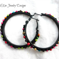 Knotted with wood beading and metal hoop earrings.