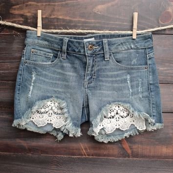 FINAL SALE - distressed denim low rise shorts with crochet detailing