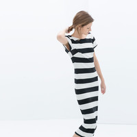 STRIPED DRESS WITH A LOW-CUT BACK