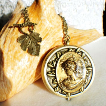Music box locket, round locket with music box inside, in bronze with victorian maiden and bronze accents