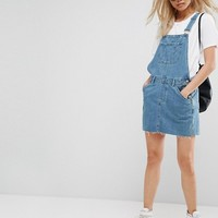 ASOS Denim Overall Dress in Midwash Blue at asos.com