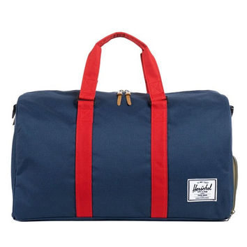 Herschel Supply Co. - Novel Duffle Bag (Woodland Camo/Navy/Red)