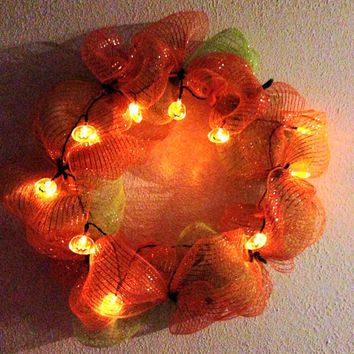 Halloween light up pumpkin wreath. Orange and green deco mesh 12 inches