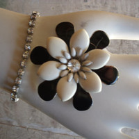 Collectible Unmarked Jewelry Set Black White And Silver Enamel Flower Pin With Rhinestone Center And Rhinestone Bracelet Jewelry