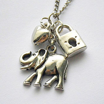 SALE! Love will draw an elephant through a key hole pendant necklace