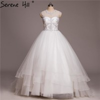 White Sleeveless Tulle Wedding Dress Embroidery Tiered Sexy Bride Gown