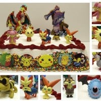 Black and White Version Pokemon 17 Piece Cake Topper Featuring Victini, Watchog, Lillipup, Herdier, Tranquill, Audino, Sandile, and Klink, 6 Pokemon Buttons and Pokemon Cake Decorations