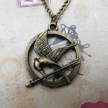 Fashion bronze Hunger games Pendant Necklace by beadsstore on Etsy
