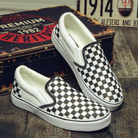 Black White Grids Vans Checkerboard Slip-On Sneakers