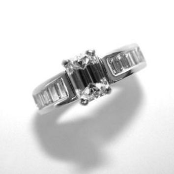 A Perfect 2.2CT Emerald Cut Russian Lab Diamond Ring with Channel Set Baguettes