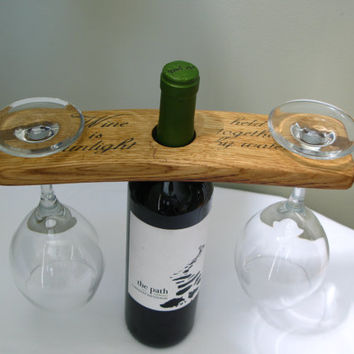 "Wine Barrel Stave Caddy with quote ""Wine is sunlight held together by water""."