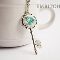 Hand stitched embroidery silver key pendant, turquoise feather necklace, embroidered necklace, silver pendant necklace