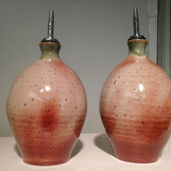 Oil or Vinegar pottery jars, in cream, brown and green, with spout, by Hatfield Pottery in Seagrove, NC