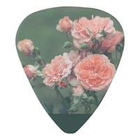 Beautiful pink roses on a natural green background guitar pick