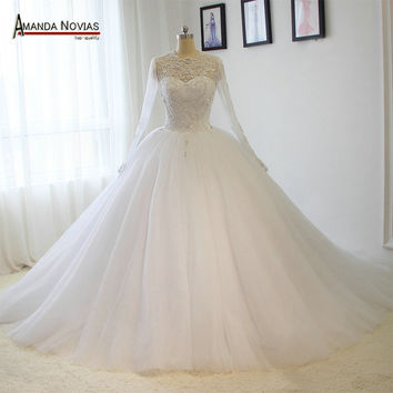 Amazing puffy ball gown long sleeves beading wedding dresses 2016