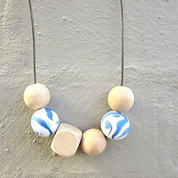 NL-179 Sea Blue and White Marble Vein Swirl Pattern Polymer Clay and Wooden Bead Necklace in Adjustable Leather Cord
