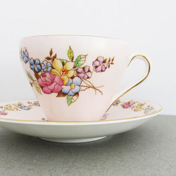 Very pretty Foley Bone China pale pink / soft pink floral tea cup and saucer with colorful flowers - Excellent condition - Made in England