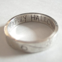 Harry Potter etched silver ring inside reads 'DEATHLY HALLOWS'