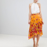 ASOS DESIGN satin wrap midi skirt in floral print at asos.com