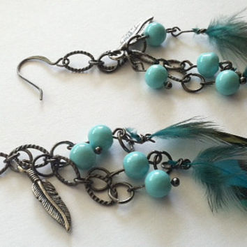 Super cute gunmetal tone dangling real feather and feather charm earrings by Peachykeenthings
