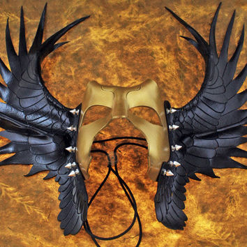 Odin's raven mask in black and gold leather.