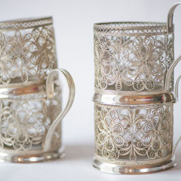 Vintage tea glass holders set of 4 filigree podstakanniks silver shades Soviet time tabelware mint condition German silver