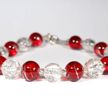 red bracelet, clear crackle bracelet